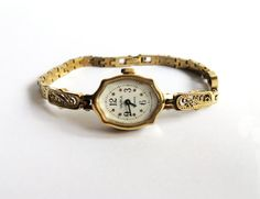 Awesome Gold Soviet mechanical watch works great. It is very miniature and elegant gold womens watch with beautiful white dial. Womens soviet watch in great condition. Works perfect. Elegant and cute wristwatch Chaika with 17 jewels. Bracelet is vintage original. Length = 7.3 inch (18.5 cm). Can be reduced. Gold watch made in 80s. Wind-up watch everyday. I offer ENGRAVING on back cover of watch: https://www.etsy.com/listing/217599005/engraving-on-watch-in-back-case-of-any…