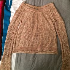 Free People off-the-shoulder Sweater Free People off the shoulder sweater. This is a reposh because although I love this sweater I never wore it! It's a cream and rust color combination, almost rose gold looking. Size XS. Price negotiable Free People Sweaters