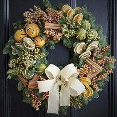 Wreaths are a classic Christmas tradition and they're great fun to make! Here's a list of over 80 beautiful Christmas ideas. Christmas Door Wreaths, Christmas Door Decorations, Christmas Flowers, Rustic Christmas, Christmas Time, Christmas Crafts, Christmas Reef, Traditional Christmas Tree, Advent