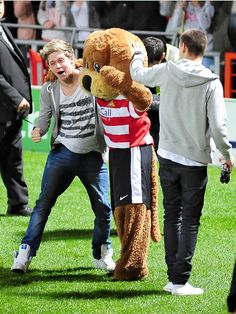 "Niall, Liam and the mascot at Louis' charity ""Football"" game"