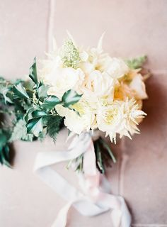 Soft spring bouquet! Photography : Katie Julia Read More on SMP: http://www.stylemepretty.com/2016/08/11/modern-white-grey-english-tent-wedding/