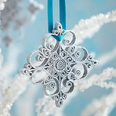Quilled snowflake. Basically curled cardstock pieces glued together