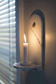 "Stone Candle Sconce 5""w x 5""d x 11.5""h Price: $420"