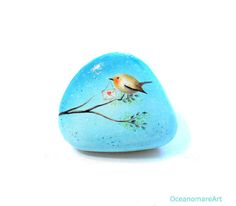 Painted stone sasso dipinto a mano. Bird with by OceanomareArt