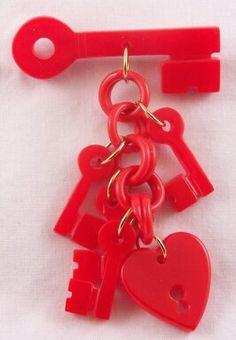 DB3 red bakelite heart/key pin