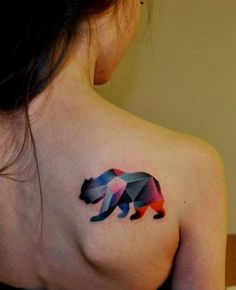 Prism coloured animal tattoo on back