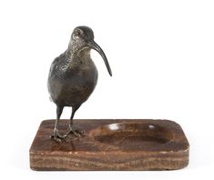 An Austrian cold painted bronze bird statue mounted on an Italian brown onyx base, circa 1900, 16cm high / MAD on Collections - Browse and find over 10,000 categories of collectables from around the world - antiques, stamps, coins, memorabilia, art, bottles, jewellery, furniture, medals, toys and more at madoncollections.com. Free to view - Free to Register - Visit today. #Bronze #DecorativeArts #MADonCollections #MADonC