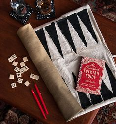 Entertaining: Old-fashioned Parlor Game Party. We created a portable backgammon board by sewing some canvas to a heavy army fabric backing and stenciling 12 thin triangles onto each side. #party #games #diy