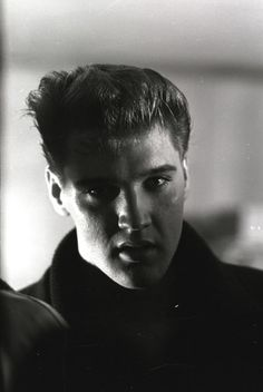 """This shot of the King of Rock & Roll was taken in Memphis, Tennessee, on March 15, 1960: Elvis had just returned to the U.S. from his stint in Germany with the army, which clearly had not done permanent damage to his amazing hair. A few days later, Elvis would go into a Memphis studio and cut his first post-army single, the number one hit """"Stuck On You."""""""