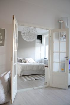 Ikea PS Maskros lamp & french windows. Calm, white & fresh interior.