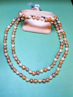"""Multi Color Pearl Bracelet With Sterling Silver Clasp $200  21"""" Multi Color Pearl Necklace With Sterling Silver Clasp $450  22"""" Multi Color Pearl Necklace With Sterling Silver Clasp $450  Har"""