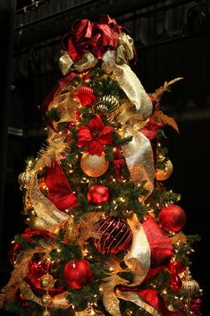 Red and Gold 9ft Christmas Tree decorated on a stage for Commerce Casino