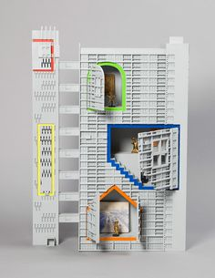 Tower of Fable by FAT architecture in collaboration with artist Grayson Perry: tower of fable is a fantasy about a very real piece of architecture: a toy sized remake of the balfron tower. this transformation brings out qualities of goldfinger's architecture that lie just beneath its surface. brutalism here is revealed as exciting as a country cottage.
