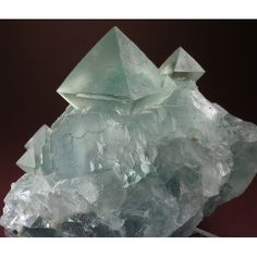 Fluorite,  Locality: Xianghualing Mine, Hunan Province, China   Dimensions: 9 x 9 x 8.1 cm. This is a naturally occurring octahedral form Not Cut or fashioned by man...