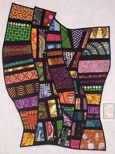 funky & creative quilt but want to make it into a room screen / divider instead - great DIY idea