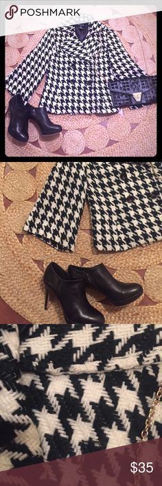 Houndstooth Blazer Gorgeous large houndstooth patterned blazer. Great styling with bell shape sleeves. It's missing one black button. A little wear on one side where my handbag rubbed against it. It's a great jacket. Focus 2000 Jackets & Coats Blazers