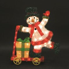 "LB International Skateboarding Snowman Christmas Decoration, 6"" x 26"" x 29"" tall. $129.99 at Walmart.com, 10/29/15"