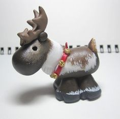 His balance is off, but I like the concept. He has charm. Reindeer, polymer clay, sculpy