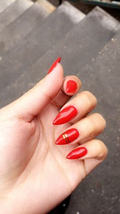 Red and gold stiletto gel nails