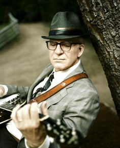 STEVE MARTIN- because I love banjo and bluegrass music.and Steve Martin can flat tear up a banjo.