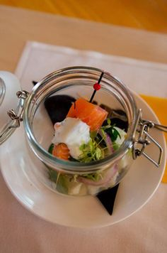 Atlantic salmon, lightly cured, served in a smoking jar with scattered potato salad