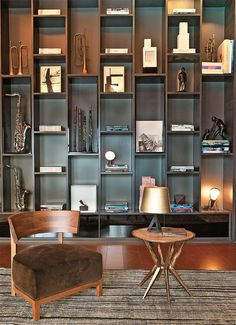 unique staggered shelves, dark painted