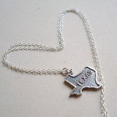 This Texas necklace created by Jewelry By CARMAL is made of: Sterling Silver: Texas charm, link chain, findings and spring clasp closure. This
