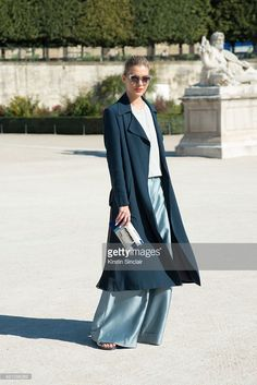 Fashion Blogger Dasha Gold wears a Bianca Spender trousers and coat, Extraordinary Ordinary shoes, Haati Chai and Crystal Eclipse jewellery and a Sarahâs Bag clutch on day 4 during Paris Fashion Week Spring/Summer 2016 on October 2, 2015 in London, England.