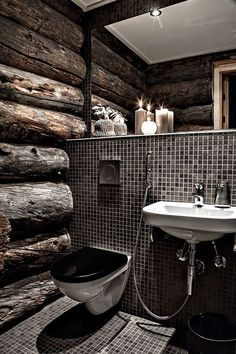Black and wood bathroom. Sink and toilet make it feel like a restaurant bathroom.