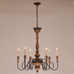 This vintage chandelier will look gorgeous over a  kitchen countertop or a dining table to add a warm, friendly feeling.