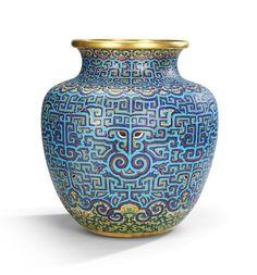 A rare and large Imperial archaistic gilt-bronze and cloisonné enamel vase, zun Qianlong. 清乾隆 銅胎掐絲琺瑯仿古饕餮紋大尊  乾隆皇帝在藝術上主張仿古之風,極其重視宮中所藏商周清宮彝器,並對前朝特別是明代景泰年間所作銅套掐絲琺瑯器尤為欣賞,並特意下旨命造辦處照《西清古鑑》仿之。此尊仿漢代青銅饕餮紋尊,結合乾隆時期掐絲琺瑯工藝,融合如意雲頭及纏枝蓮花等新元素,凸顯乾隆一朝宮廷掐絲琺瑯慕古創新之風
