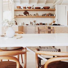 earthy neutral minimalist kitchen and dining area | open shelving | collected housewares