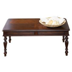 Bring a classic touch to your living room or den with this tobacco-finished coffee table, showcasing fluted legs and molding details.  P...