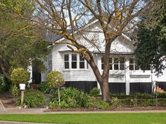 White Californian bungalow with black trim. 57 Bancroft Street Portland Vic 3305 - House for Sale #116441287 - realestate.com.au