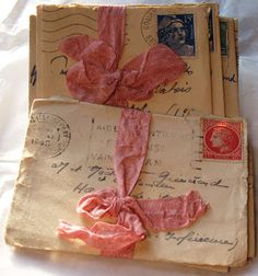 old letters tied with a pink ribbon