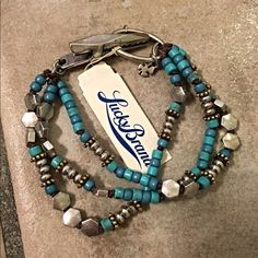 NWT Lucky brand super cute bracelet! Features a claw hook closure and variations of turquoise and blue shades set in silver tone! Lucky Brand Jewelry Bracelets