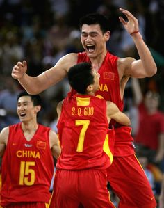 Inspirational Moments: Olympic celebrations - ATHENS - AUGUST 23: Yao Ming #13 and Shiqiang Guo #7 of China celebrate their 67-66 win over Serbia & Montenegro in the men's basketball preliminary game on August 23, 2004 during the Athens 2004 Summer Olympic Games at the Indoor Arena of the Helliniko Olympic Complex in Athens, Greece. (Photo by Stuart Hannagan/Getty Images)