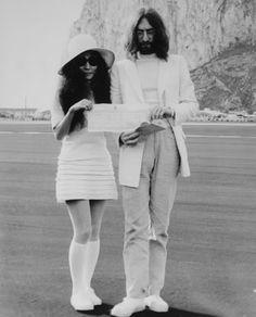 John Lennon and Yoko Ono Holding Marriage Certificate