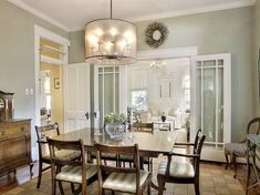 Transoms Cool Sage Walls Gloss White Trim Dark Wood Furnishings For This Dining Room Check Out The Barrel Shaded Chandelier
