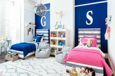 Shared Boy/Girl Room featuring @potterybarnkids furniture and decor - we love how each child has their own space yet the whole room  is cohesive! #projectsibling