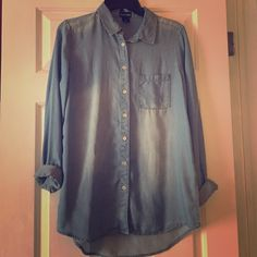 Light denim shirt Long sleeves denim shirt is in great condition!! Wet Seal Tops Button Down Shirts
