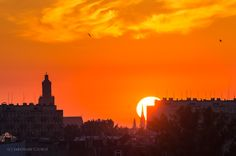 Sunrise over Wroclaw. Sun shield shines through St Michael's Church tower.