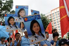 Supporters of the Workers' Party hold posters of their party's candidate Lee Li Lian at the nomination center in #Singapore on Jan. 16, 2013. Photographer: Roslan Rahman/AFP/Getty Images