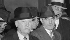 "With their ill-famed jail breaking prisoner, ""Count"" Victor Lustig (center), two deputies closely guard the ""bad man"" on arrival at Federal ..."