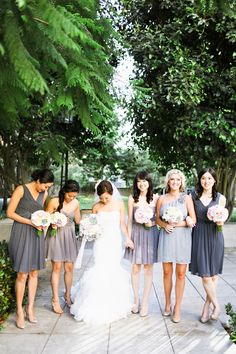 Pretty maids in grey | Los Angeles Garden Wedding from Adrienne Gunde Photography  Read more - http://www.stylemepretty.com/california-weddings/2013/09/20/los-angeles-garden-wedding-from-adrienne-gunde-photography/