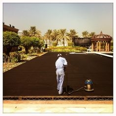 #ADFF12 @Silviarazgova - The black carpet for the outdoor lounge area gets a spruce up ready for the festival