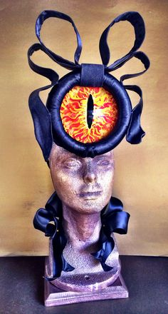 Eye of Sauron hat inspired by Phillip Treacy's Beatrice fascinator. It also lights up. #LordoftheRings Lady Bird's Hatberdashery