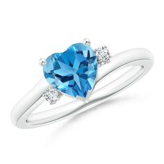 Solitaire Heart Blue Topaz Bypass Ring with Diamond -Exuding a tranquil aura, this elegant blue topaz and diamond ring is crafted in lustrous 14k white gold.