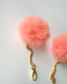 I love fun keychains and these pom pom fur balls seem to be all the rage these days. My DIY version is made with tulle so they're the eco-friendly, much cheaper version and simple to make.  Using card