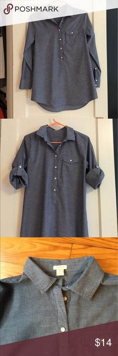 """J Crew Chambray Cotton Tunic Top J Crew factory really soft cotton chambray tunic top. Can wear with leggings or jeans. Long sleeves with tab to roll up. Great shape. Shoulder to hem 28"""" front and 30"""" rear. Underarm width approx 20"""". J. Crew Tops"""